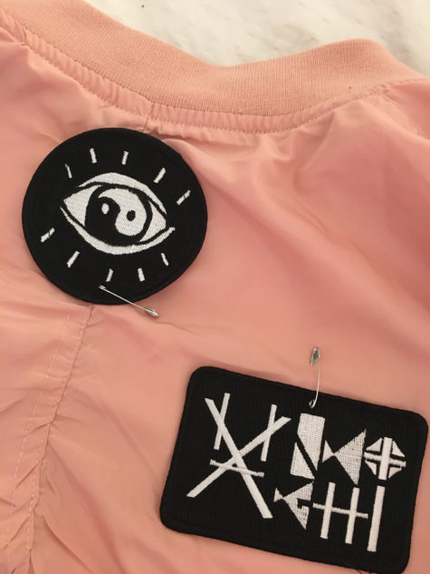 pink bomber jacket with patches safety pin