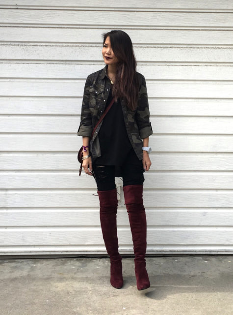 Jenny is wearing a camo jacket and burgundy otk boots